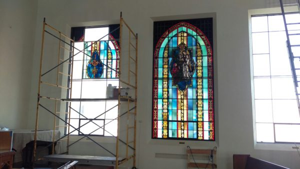 Old stained glass being removed