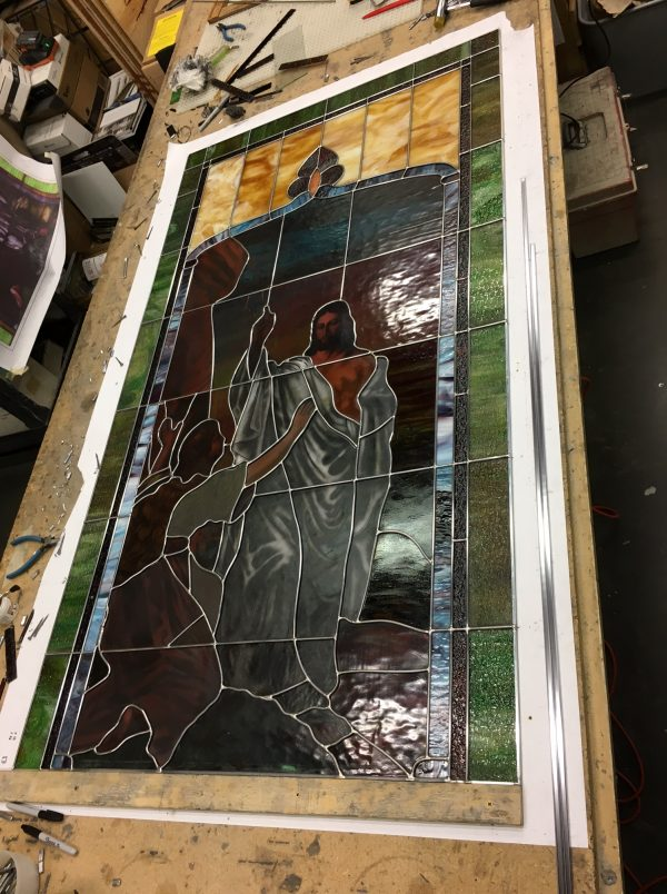 The stained glass is rebuilt using all new lead